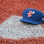 Blue Hat on baseball field ground