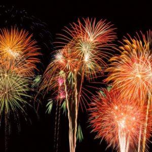 Orange Fireworks in night sky